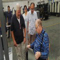 UPG accompany with customers to do the inspection of printing machine